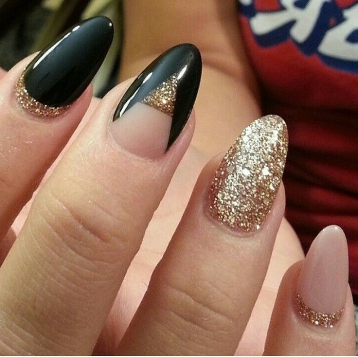 sparkling gold glitter, and glossy black nail polish, decorating an oval nude manicure, best nude nail polish, seen in close up