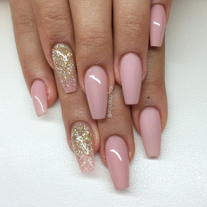 smooth and glossy pink nail polish, on a ballerina-style manicure, decorated with gold, and rose gold glitter, nude nails with glitter, on two hands