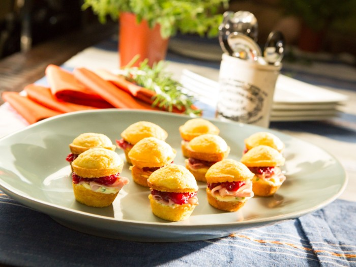 sandwich bites with ham, cream cheese and stuffing, on a large round plate, hour derves for special events