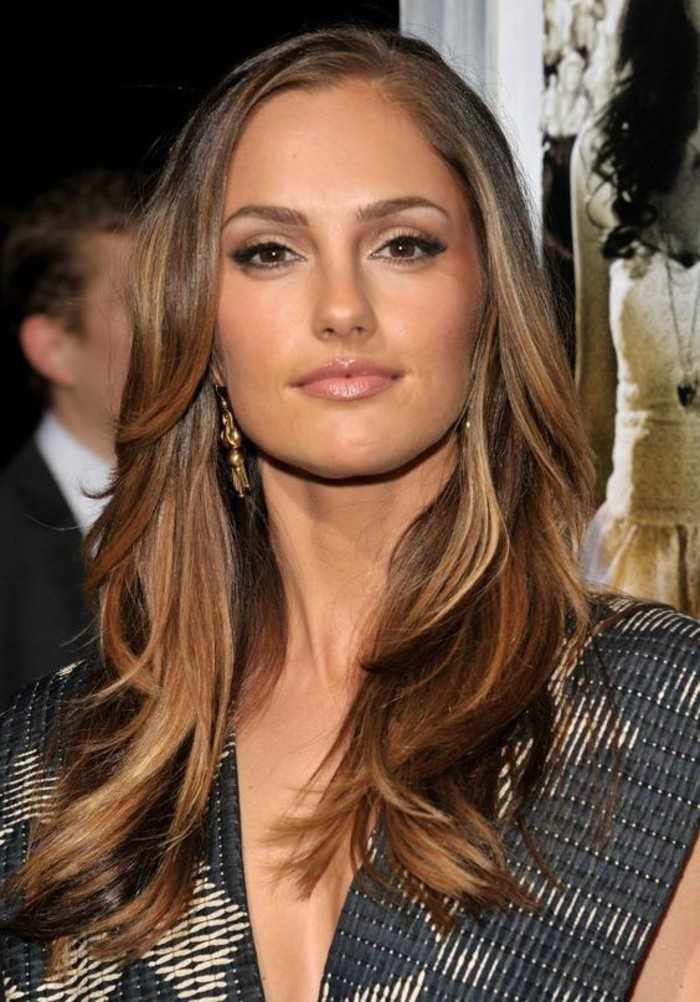 balayage with caramel tones, on medium length, dark brunette hair, worn by a smiling young woman, in a formal dress