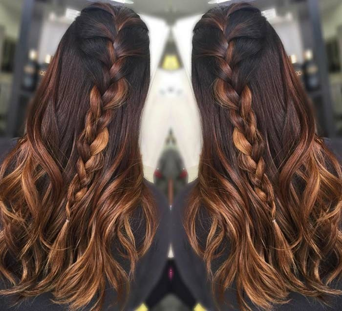 mirrored image of long, wavy dark brunette, caramel balayage hair, with a single braid,