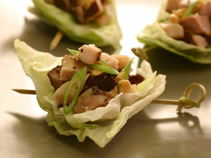 chinese inspired horderves ideas, stuffed cabbage leaf, with stir fried pork, and spring onions