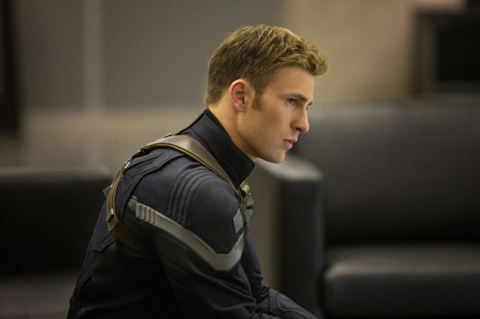 chris evans as captain america, in a black and grey suit, with cropped blonde hair, modern haircuts for men, crew cut style