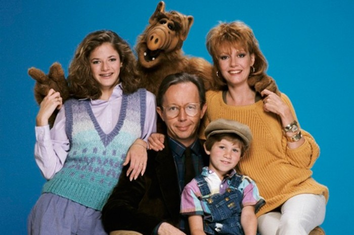alf actors posing together, dressed in vinatge clothes, 80s fashion trends, knitted sweater and vest, smart suit and dungerees, typical 80s fashion