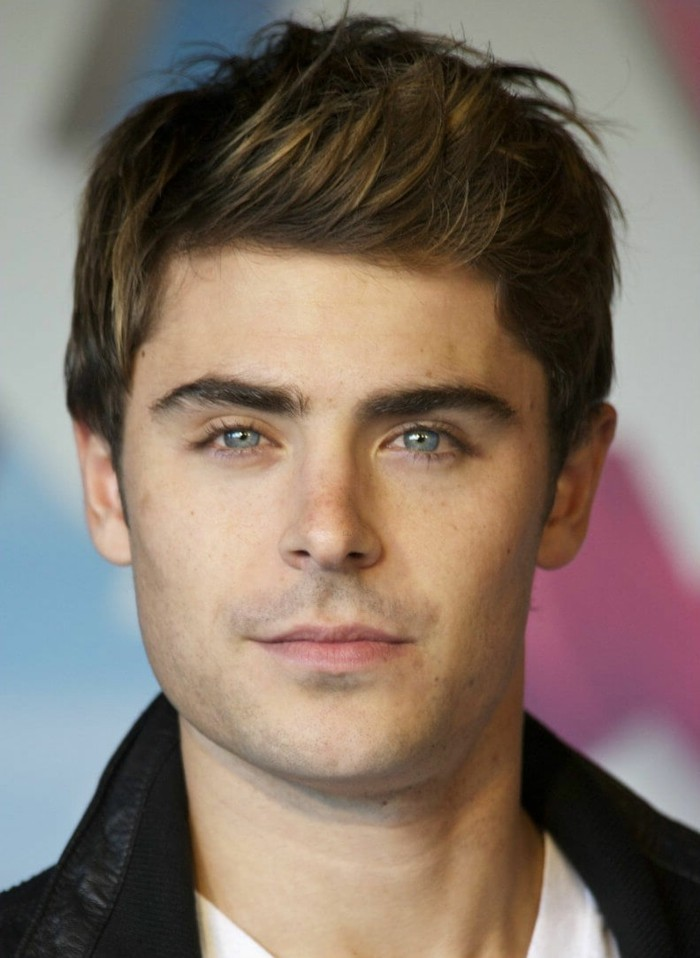 zac efron with brunette hair, featuring subtle highlights, and styled in a quiff, short guy haircuts