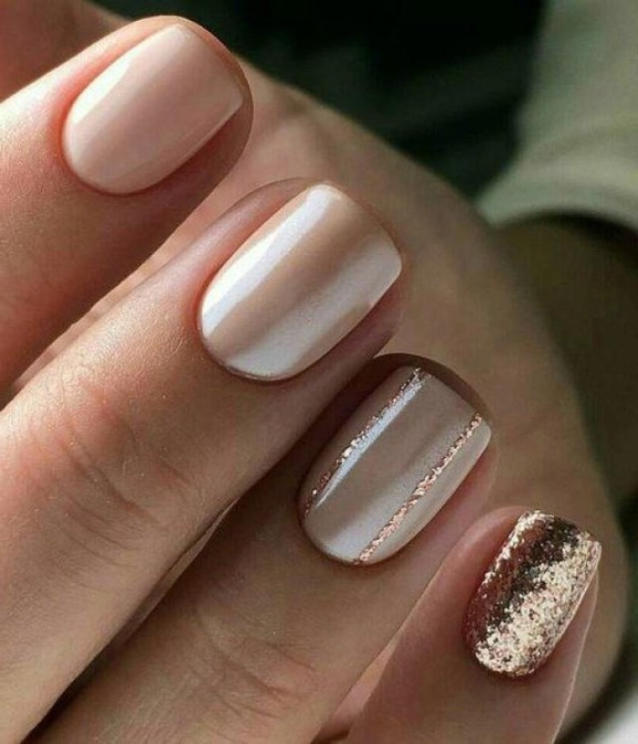 glossy pink nude nails, seen in an extreme close up, two are left plain, while the other two are decorated with rose gold glitter