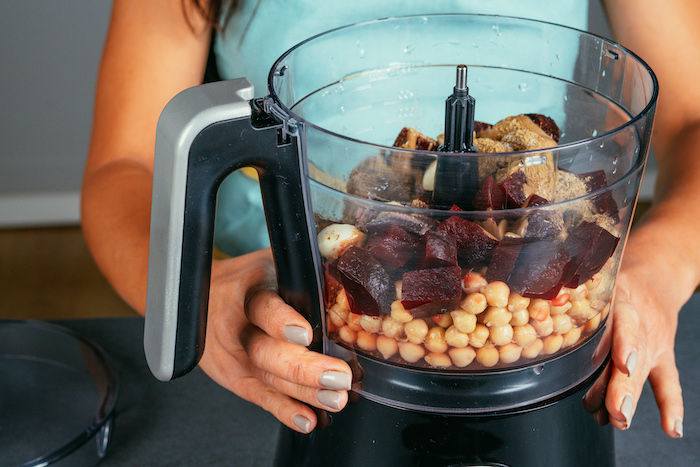 chickpeas and beetroot, all ingredients placed in a blender, beet hummus recipe, placed on black surface
