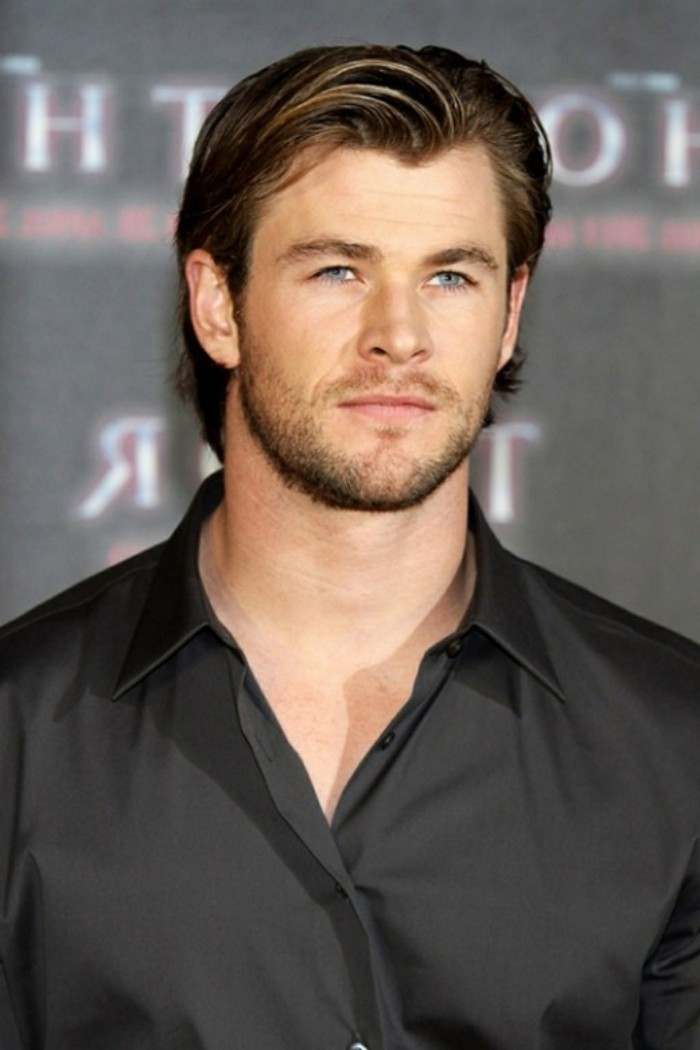 smart black shirt, worn by chris hemsworth, with brunette hair, side parted and bangs swept to one side, trendy haircuts for men, worn by hollywood stars