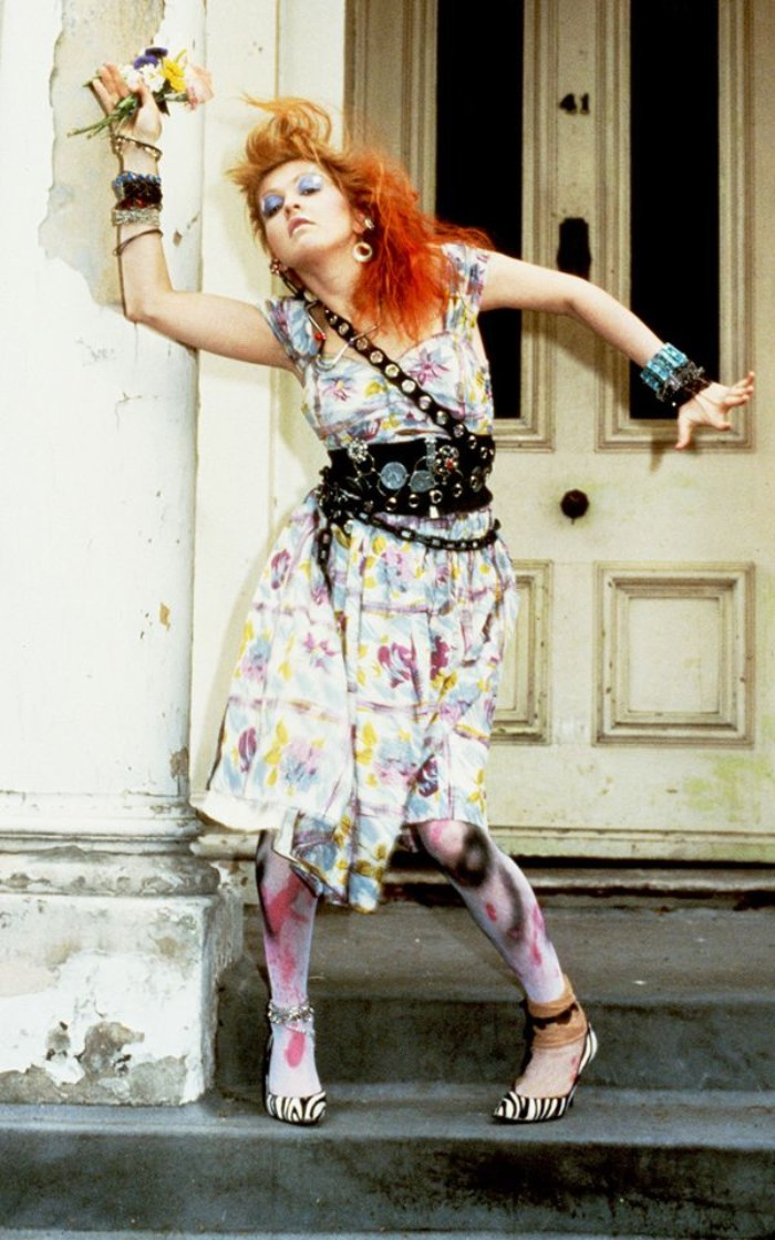floral midi dress, in pale colors, worn with a studded black leather belt, and chain details, by cyndi lauper, tights with spray paint motifs, zebra print high heels