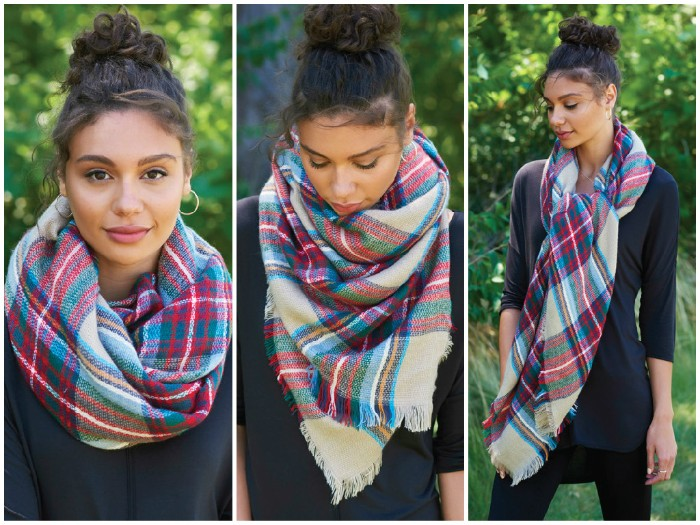 curly brunette woman, with a top knot, showing us how to wear a square scarf, in three different ways, black casual outfit, classic plaid scarf