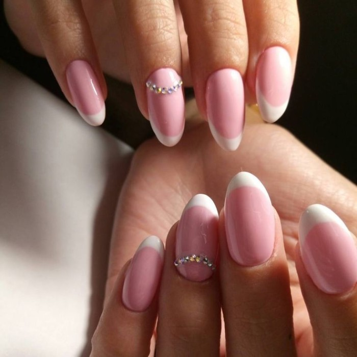 acrylic nail shapes, on two hands, with french manicure, both ring finger nails are decorated with rhinestones