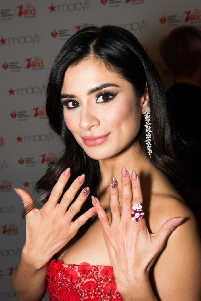 stiletto nails in nude colors, decorated with an animal print motif, worn by diane guerrero, in a red strapless dress