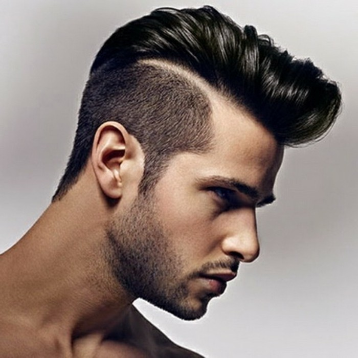 pompadour with a disconnected undercut, worn by a black-haired man, types of haircuts for men, with stubble on his chin and upper lip