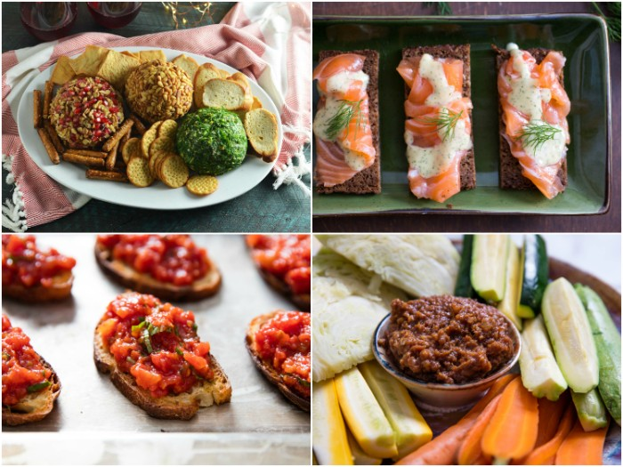 different kinds of hor dorves, crackers with three spreads, smoked salmon on toast, bruschetta and veggies with dip