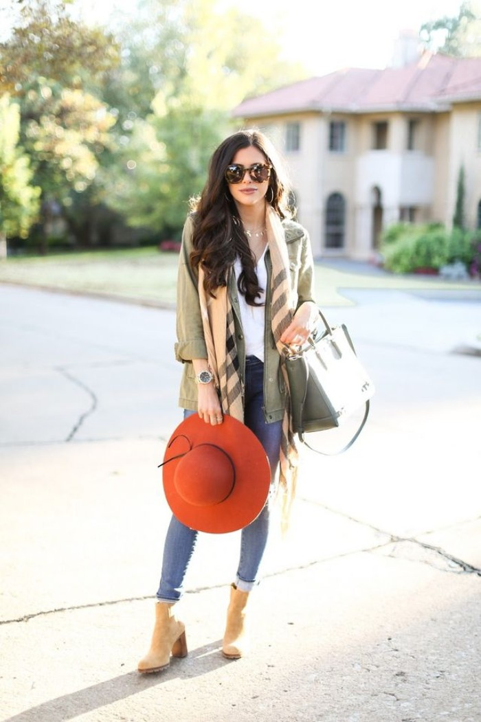 khaki green utility jacket, worn over a white blouse, and skinny jeans, by brunette woman, with large sunglasses, and a pale pink and grey shawl, scarf outfits, with a big, brick red felt hat