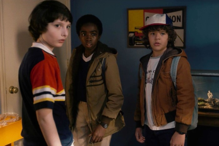 caleb mclaughlin and gaten matarazzo and finn wolfhard, dressed in retro clothes, for the series stranger things, 80s costumes men and kids, dress code nostalgia