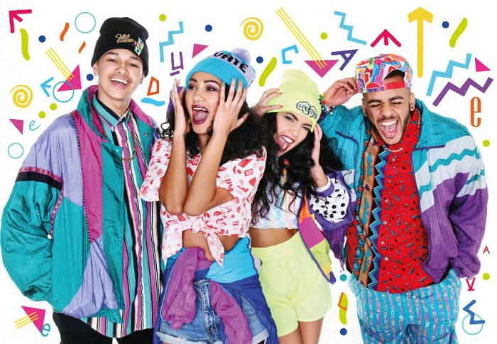 group of friends, dressed in colorful 80s clothes, teal and purple jackets, multicolored printed shirts and tops, shorts and beanie hats