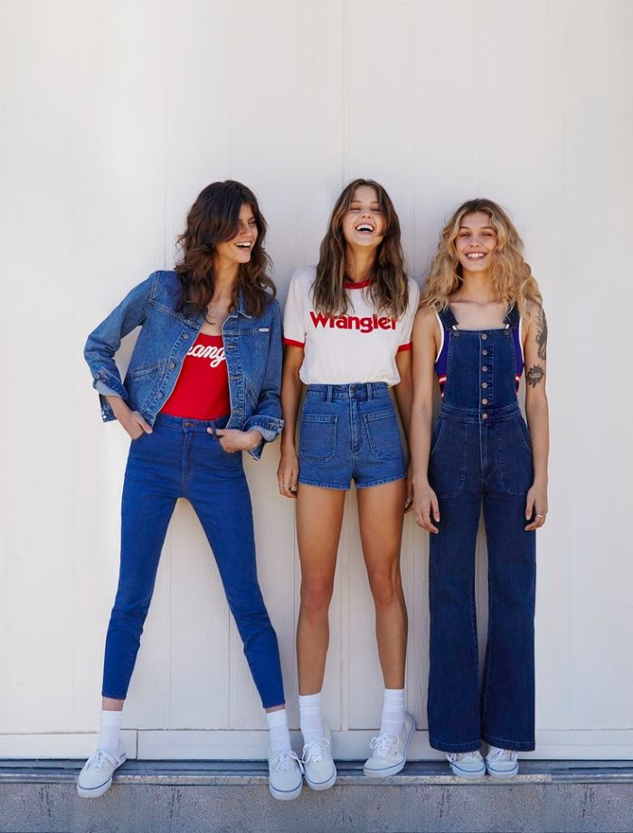 laughing young women, dressed in denim, combined with red and white tops, 80s outfits, skinny jeans and denim shorts, long denim overalls