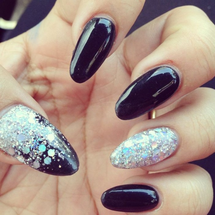 large iridescent glitter flakes, decorating a smooth manicure in black, almond nail designs, for acrylic nails
