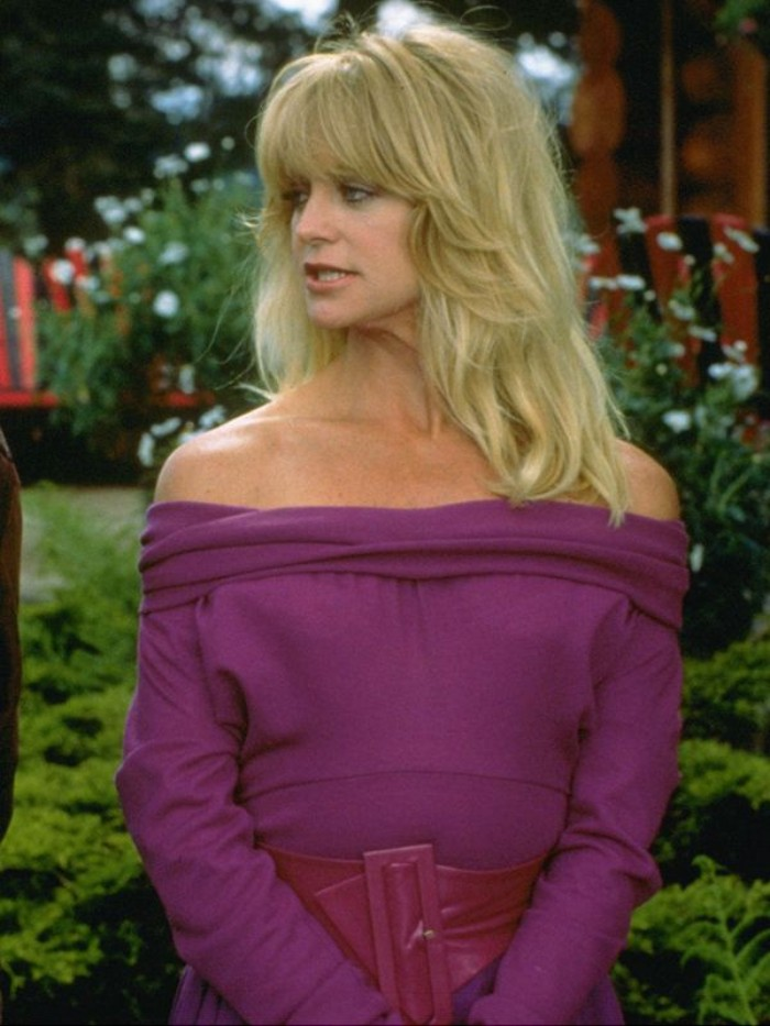 purple off-the-shoulder dress, with a wide purple leather belt, 80's fashion pictures, worn by goldie hawn, with blonde wavy hair and bangs