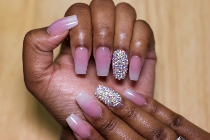 ombre-effect french manicure, on long ballerina shaped nails, nude pink nail polish, and gem decal stickers, on the ring finger nails, of both hands