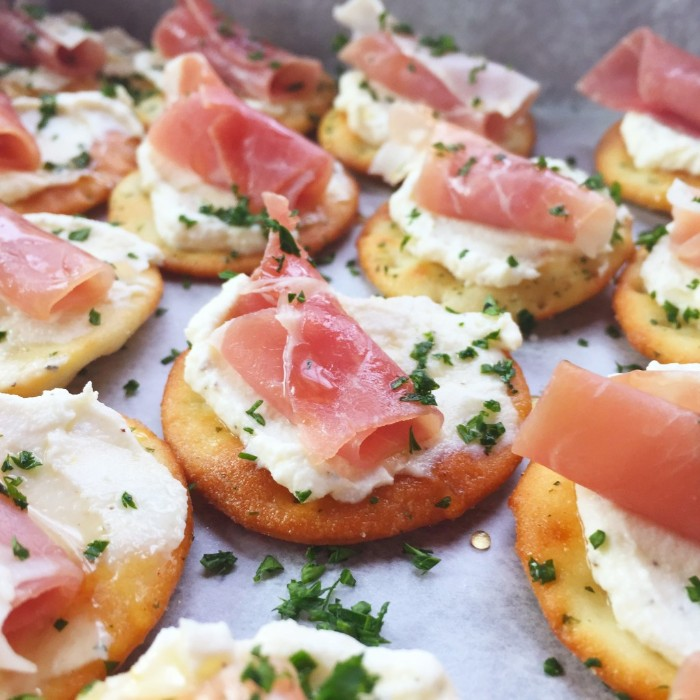 homemade crackers, topped with ricotta cheese, ham and chopped green herbs, hors d oeuvres recipes, to try at home