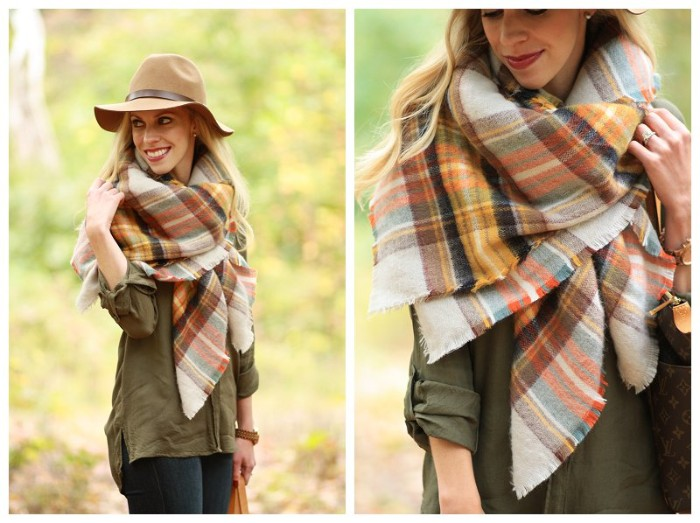 how to wrap a blanket scarf, smiling blonde woman, in a khaki shirt, and dark blue skinny jeans, wearing an oversized scarf, in warm earthy colors