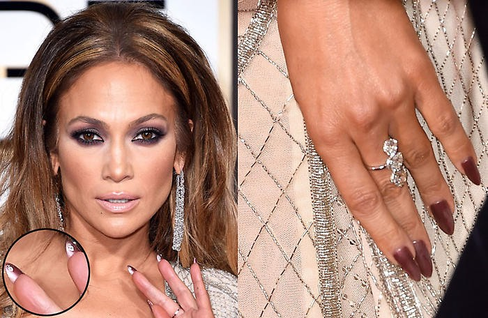 rose gold long oval shaped nails, worn by j lo, next image shows a close up of her face, with smokey eye make up, and nude lipstick