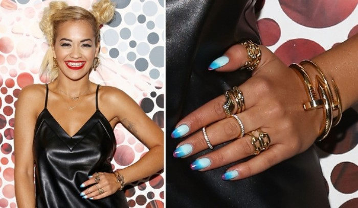 short pointy nails, painted in pale blue, turquoise and violet, worn by a smiling young woman, with braided blonde hair, and red lipstick