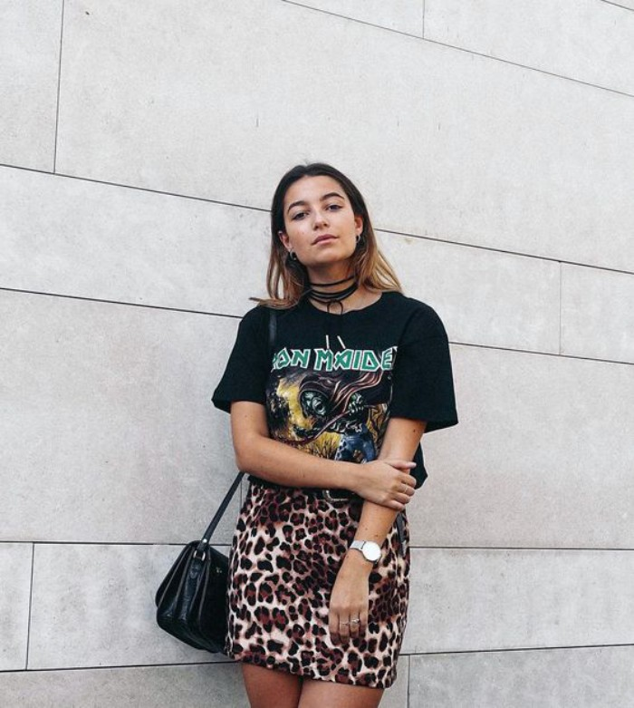 iron maiden t-shirt in black, worn with a leopard print mini skirt, 80s style outfit, on a young woman