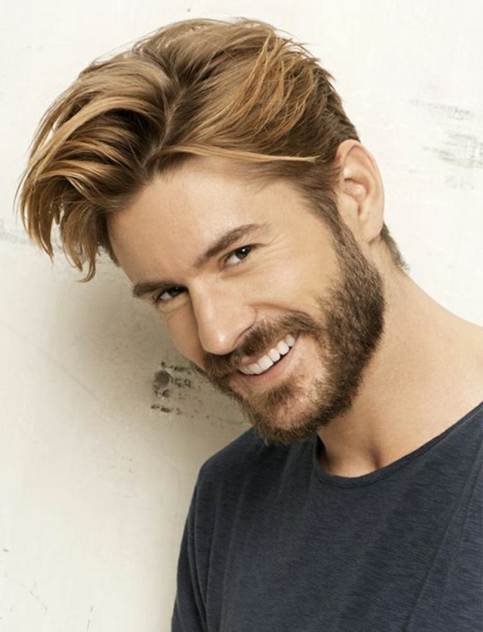 laughing bearded man, with light brunette side parted hair, and bangs brushed to one side, in a messy quiff, trendy haircuts for men
