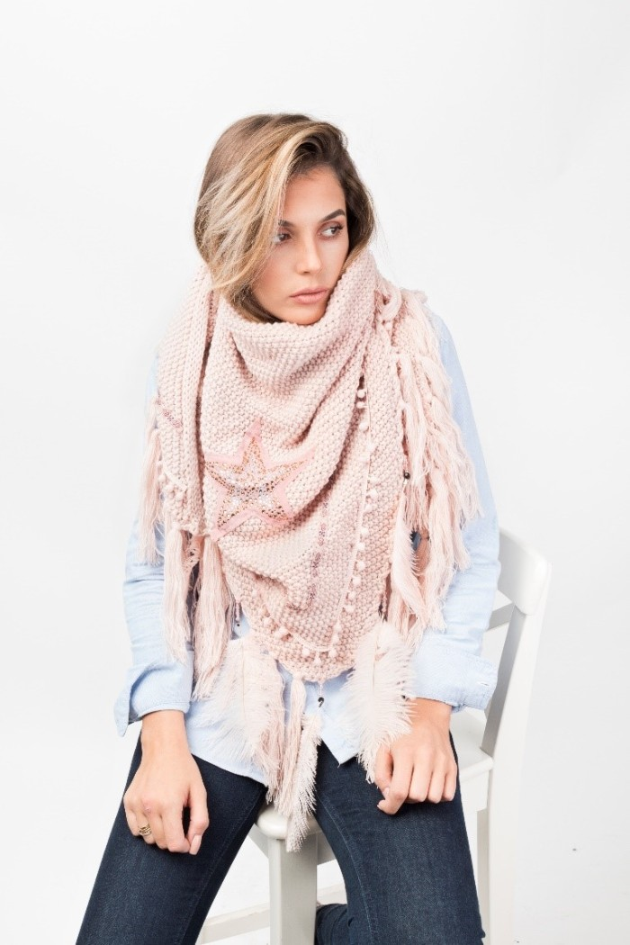baby pink scarf, with star motif and tassels, worn by a young blonde woman, in a pale blue shirt, and dark skinny jeans, how to tie a blanket scarf, for casual outfits