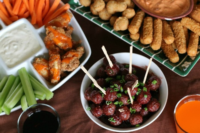 celery and carrot sticks, spicy chicken wings, marinated olives with herbs, hour derves, mozzarella sticks and other fried foods
