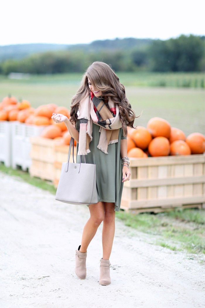 ways to wear a blanket scarf, smiling brunette woman, with long wavy hair, wearing a pale greyish blue mini skirt, with beige booties and a large shawl