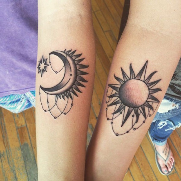 moon with a star, and a sun, tattooed on the lower part of two slim, and pale arms, tattoos for lovers or friends