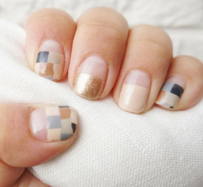 pixel effect manicure, on short square nails, in nude pink, with small squares, in pale and dark blue, grey and beige, with gold detail