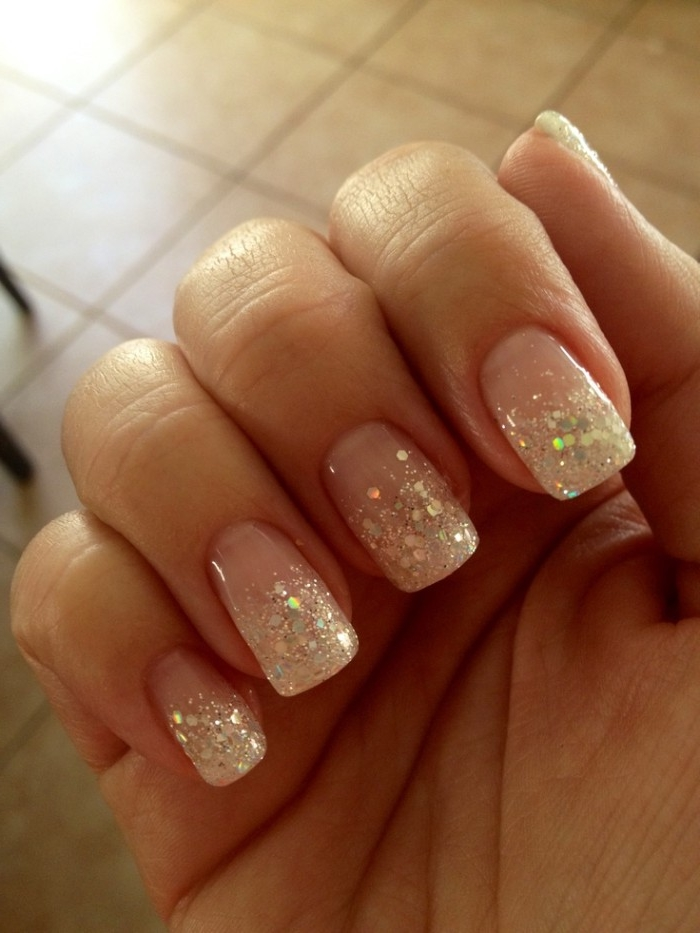iridescent glitter flakes, decorating the tips, of a square manicure, best nude nail polish, seen in close up