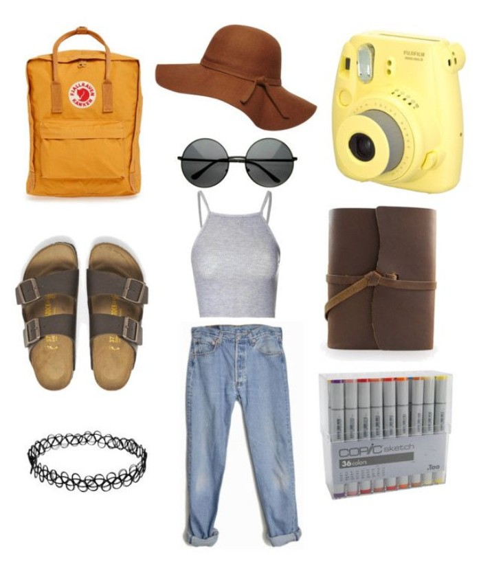 felt hat in brown, cropped pale grey top, baggy blue jeans, round sunglasses and brown sandals, orange backpack and a leather pouch, and other items