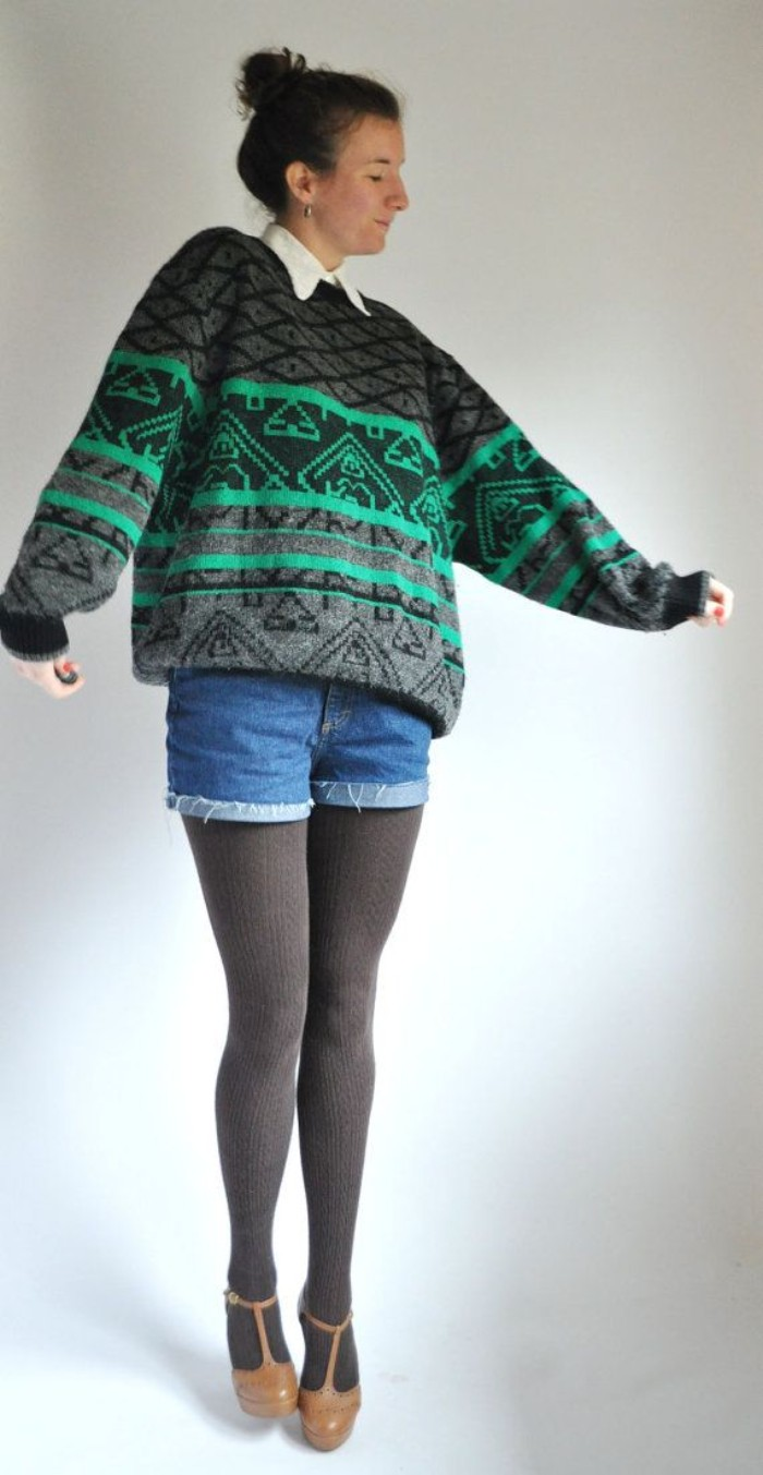 patterned sweater in grey and green, worn over a white shirt, with grey thights and denim shorts, by a young woman, with brown t-bar shoes