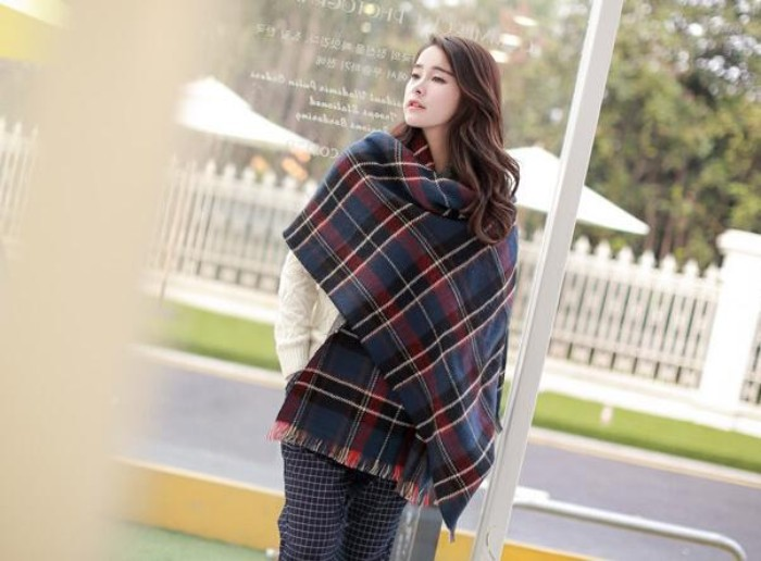 navy blue plaid oversized shawl, with black and dark red, white and grey patterns, wrapped around a pale, east asian woman, how to wrap a blanket scarf, in an original way