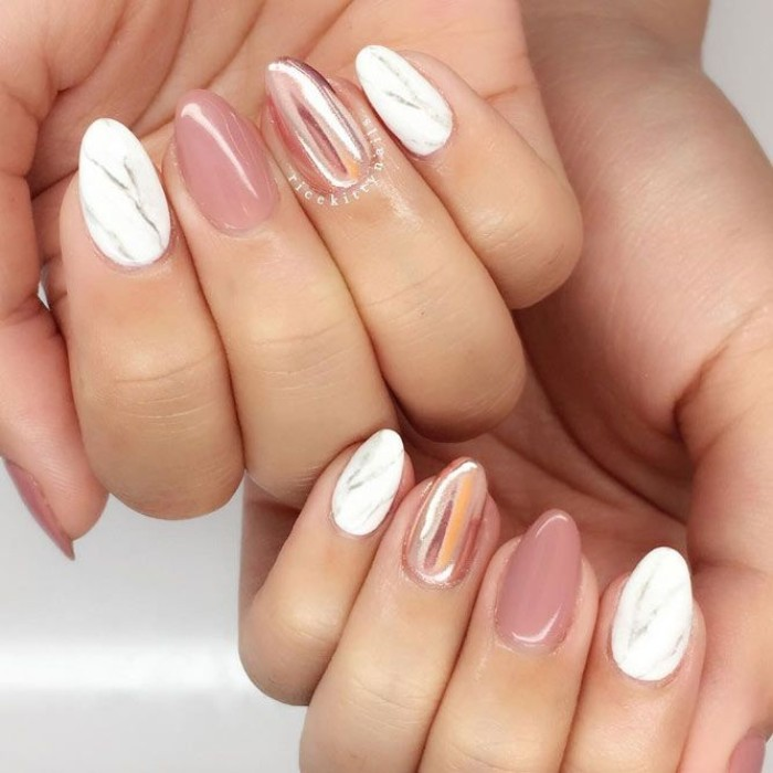 marble-like effect in white and grey, on the forefinger and little finger nails of two hands, the rest of the short pointy nails, are painted in metallic rose gold, and glossy pink