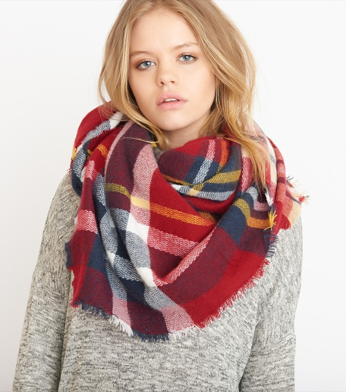 red tartan shawl, with white and yellow, dark blue and grey stripes, how to wear a blanket scarf, around the neck of a young, blonde woman