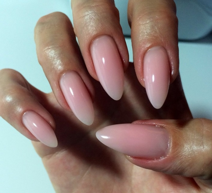 nude nail polish, smooth and glossy, milky pink nails, with a pointed, long and oval shape