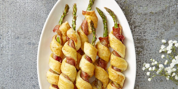 bacon and asparagus, wrapped in a pastry, hor d oeuvres ideas, placed in an oval white plate