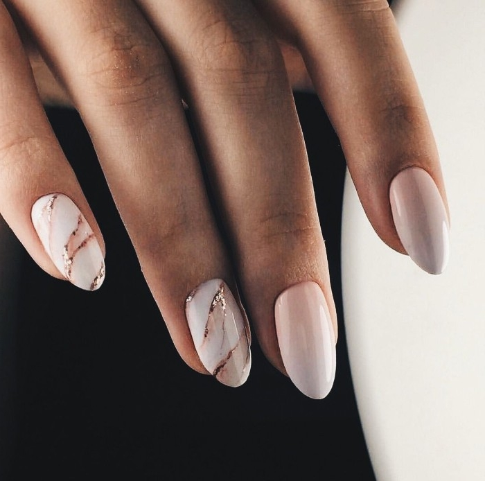 gradient and pink marble effect nails, decorated with subtle glitter details, seen in close up
