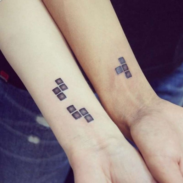 matching tattoos for couples in love, retro tetris blocks tattoos, near the wrists of two arms, each arm has a different piece, but they fit together