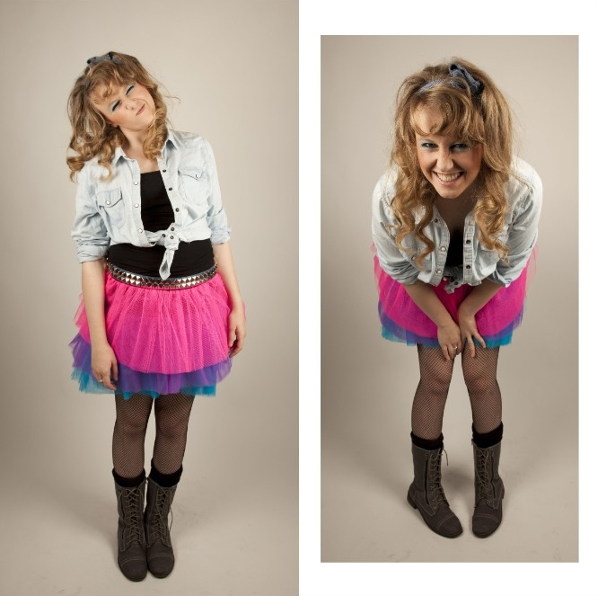 denim shirt in pale blue, tied above the waist, and worn over a black top, combined with a tutu skirt, in neon pink, purple and blue, 80s costume ideas