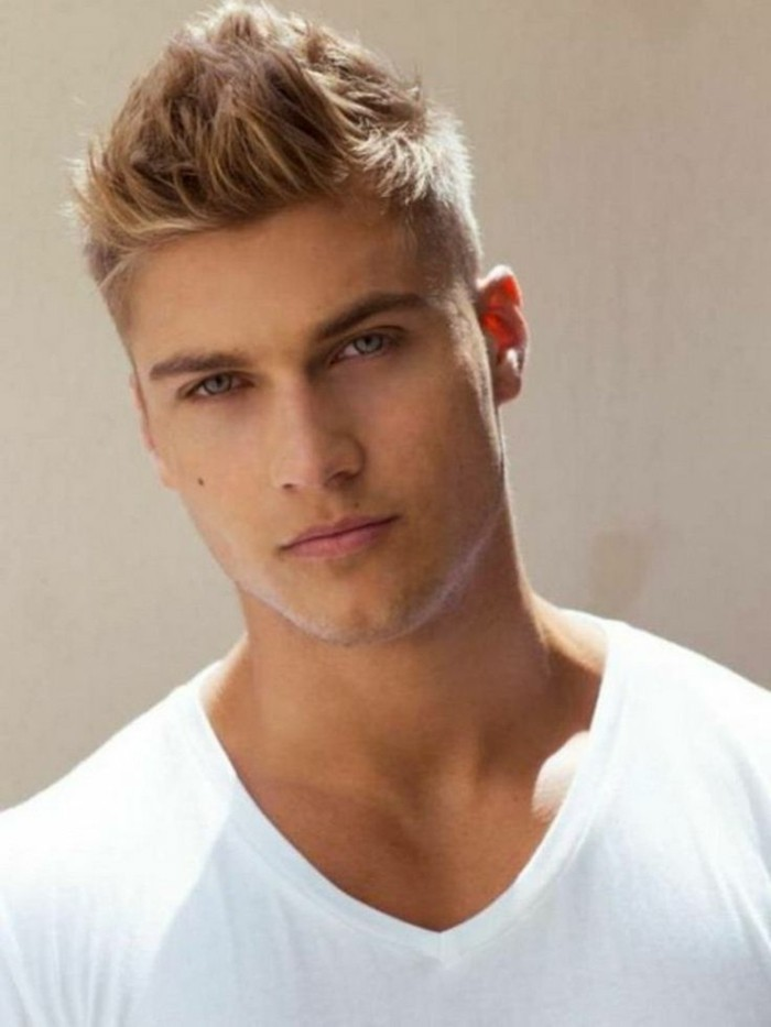 white v-neck t-shirt, worn by a young blonde man, with hair styled in a faux hawk, types of haircuts for men