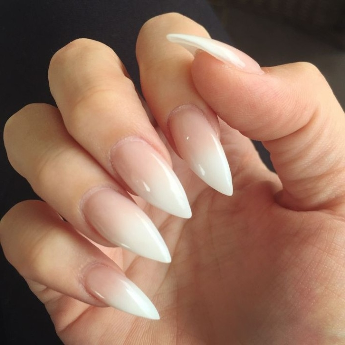 sharp and long manicure, nude nail designs, with white tips, on a hand with folded fingers