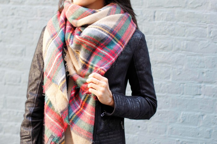 soft plaid scarf, in beige and red, blue and green, yellow and white, combined with a vintage, distressed looking leather biker jacket, how to wear a square scarf, seen in close up